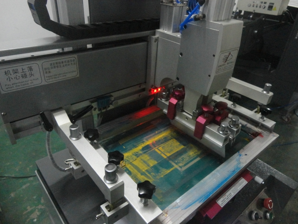 Silk Screen Printing Machine On Mobile Phone Screen Panel